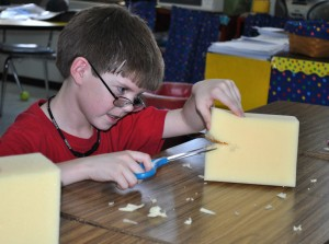 Garrett Gosser, a third-grade student at Salem Elementary School, gets to work cutting a block of Styrofoam for a puppet he is building at a puppet construction workshop